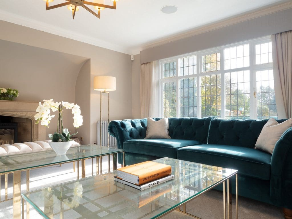 Double Glass Table and Aqua Sofa